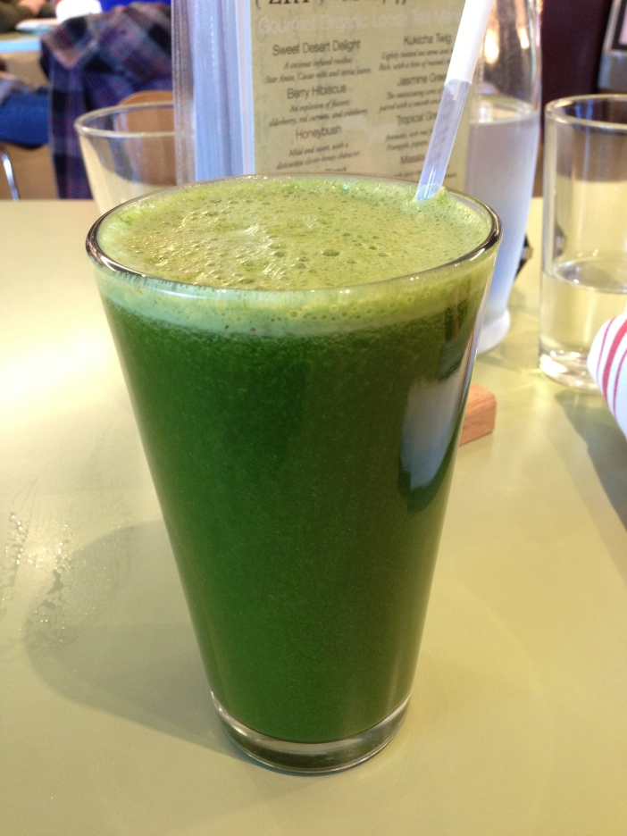 A glass of Popeye's Secret green veggie juice