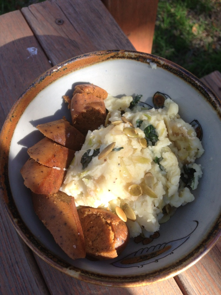 Scallion, Cabbage, and Kale Mashed Potatoes with Vegan Sausage and Pumpkin Seeds