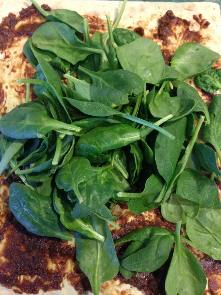 Spinach on top of barley miso smeared lavash