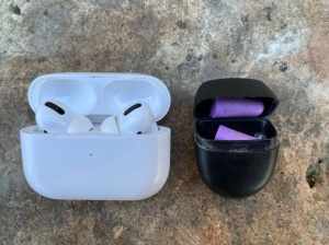 AirPods Pro and a Vibes earplugs case with purple foam earplugs